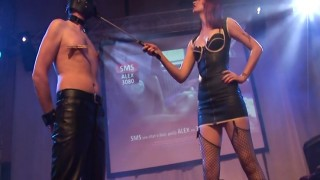 Wild domina punishing her slave at the sex show