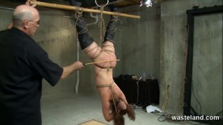 Bound slave suspended upside down gets caned and spanked by ...