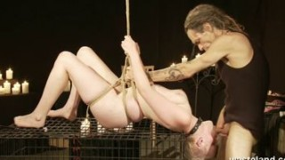 Bound On A Cage And Giving A Blowjob